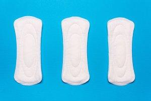 three menstrual pads