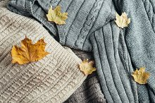 Warm winter sweaters with dry leaves by  in Beauty & Fashion