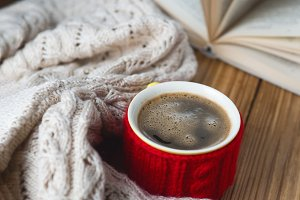 A mug of hot coffee with a warm wint