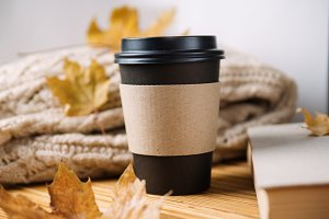 Paper Cup of coffee with warm sweate