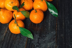 Pile of ripe juicy orange tangerines