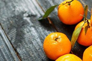 Pile of ripe juicy orange tangerines