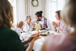 An elderly grandmother celebrating