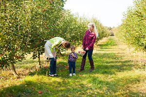 Two woman and a girl at the orchard