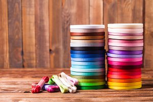 Colorful ribbon bobbins on the