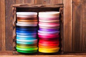 Colorful ribbon bobbins in the