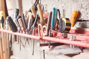 Carpenter tools fixed on the wall at