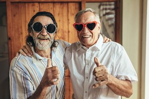 Retired friends with party eyewear