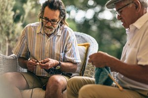 Retired male friends doing knitting