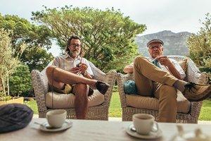 Senior men sitting relaxed