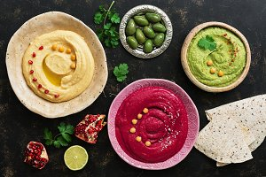 A variety of colored hummus in a