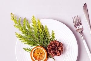 Christmas table setting. Plate and c