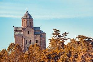 Ancient church among the autumn