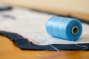 Spool of thread in a sewing workshop