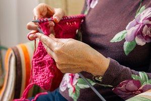Hands of woman knitting a wool sweat