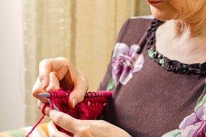 Woman knitting a wool sweater
