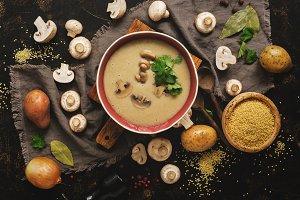 Mushroom cream soup on rustic