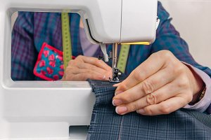 Seamstress hands working on a sewing