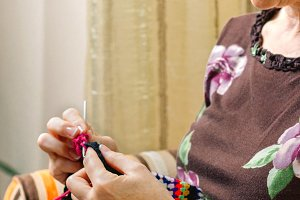 Portrait of woman knitting a vintage