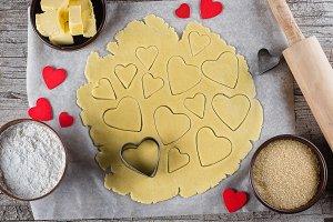 Baking love heart cookies for Valent