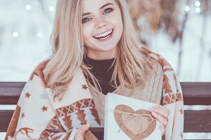 Smiling young woman with christmas p