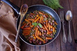 Skillet with peas, carrot, ham, spoo