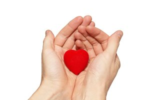 Small valentine heart in a hands.