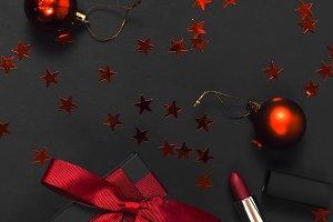 Black gift box, lipstick, balls