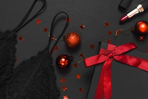 Black gift box, lace bra, lipstick