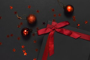Black gift box with red ribbon, ball