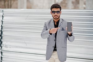 Casual young indian man in silver ja