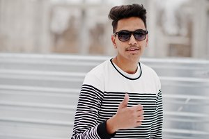 Casual young indian man in sunglasse