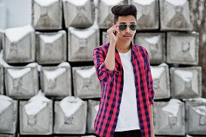 Casual young indian man in checkered