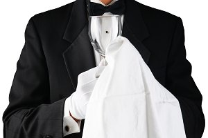 Closeup of a Waiter in Tuxedo Polish