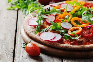 Vegan pizza with radish