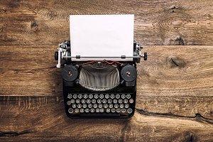 Vintage typewriter with paper