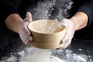 round wooden sieve with flour