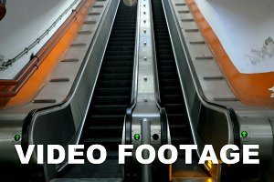 Empty underground escalator moving