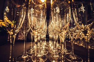 Empty champagne glasses in row