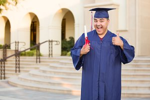 Hispanic Male Graduate With Diploma