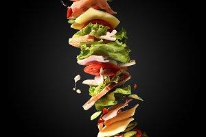 Flying sandwich on dark background