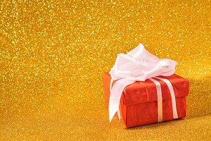 Gift box on gold background