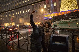 Couple taking selfie during snow