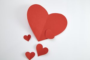Paper red hearts on white background