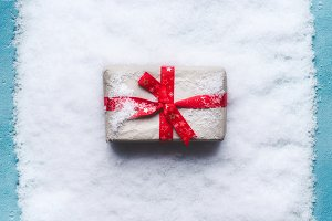 Christmas gift box on snow
