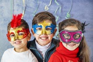Three kids celebrating Carnival