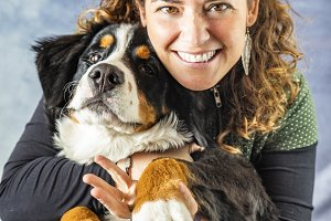 Middle aged woman with a Bernese dog