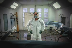 Worker Inside Painting Booth