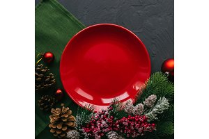 Christmas table with red plate and