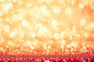 Golden glittery bokeh background.